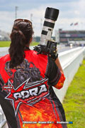 Tara Bowker of Black Rock Photography Prepares to Take photos of the Stanley And Weiss Racing Cadillac CTS-V PDRA Pro Extreme Pro Mod With Wicked Grafixx PDRA logo on her shirt